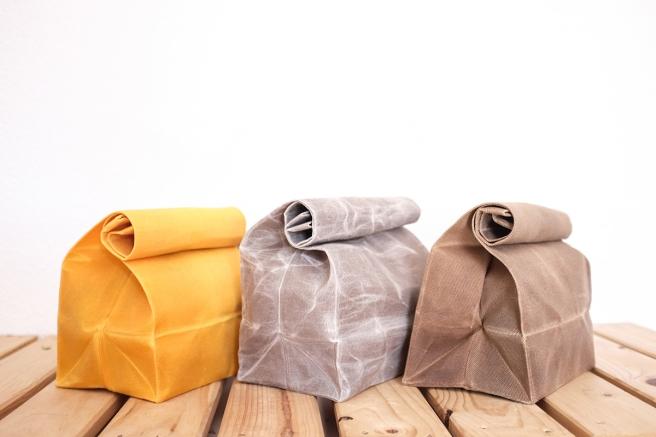 iconic paperbag waxed canvas bolsa papel americana almuerzo lunch iconica tela encerada impermeable cera pipolart marron amarillo mostaza detalle